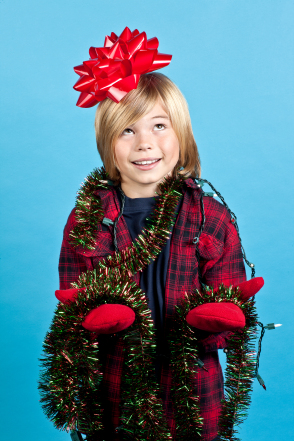 elementary boy with christmas decorations